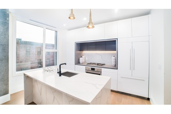 Brand New Floor-through Three Bedroom, Two Bath Residence with Step Out Balconies in Greenpoint